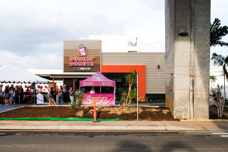 The first Dunkin' Donuts location sits below the airport viaduct onramp on the corner of Ualena and Paiea Streets.