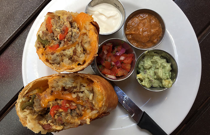 The BrunCHonga ($13) comprises a deep fried, large burrito stuffed with sausage, bacon, scrambled eggs, hash browns and cheese. It's served with fresh guac, sour cream and roasted tomato salsa.