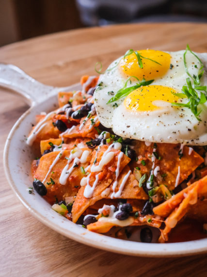 The chilaquiles ($24) has crispy tortilla chips layered with Portuguese sausage, beans, eggs, ranchero sauce, cotija cheese and crema.