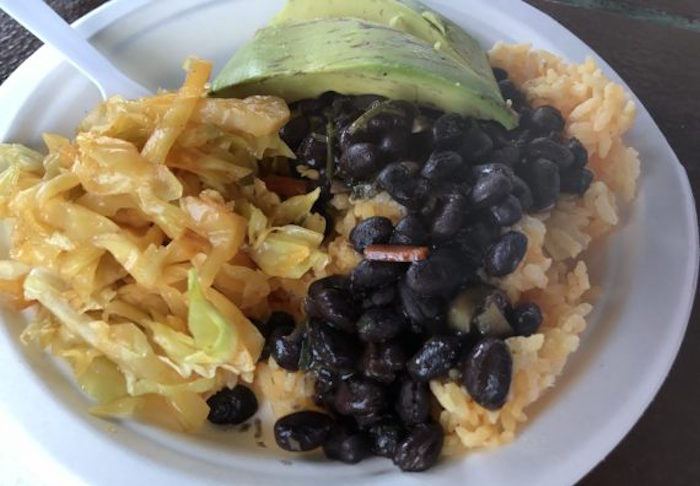 Vegetarian plate from the Puerto Rican vendor: Arroz Con Gandules topped with pickled cabbage, avocado and black beans