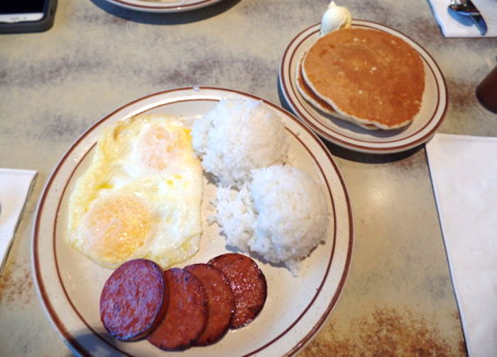 Portuguese Sausage Plate with over-easy eggs and pancakes ($12.95)