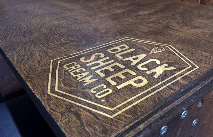 The company's logo is on every wooden table.