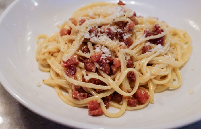 This carbonara includes slab bacon, Portuguese sausage, Parmigiano-Reggiano and Pecorino Romano. Photo by Thomas Obungen.