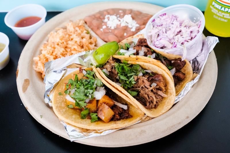 The tres (three) taco plate is filling for $12 and includes your choice of any three tacos, rice, beans and slaw.