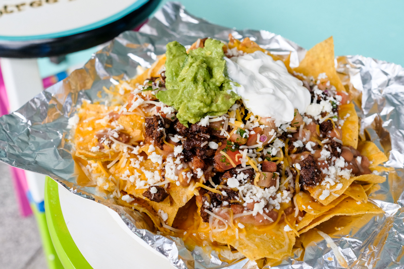 One look at these loaded carne asada nachos ($10) and you're instantly kanaking.