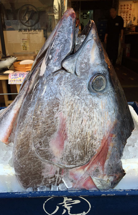 Many vendors display fish heads in front of their stands to show their products are fresh.