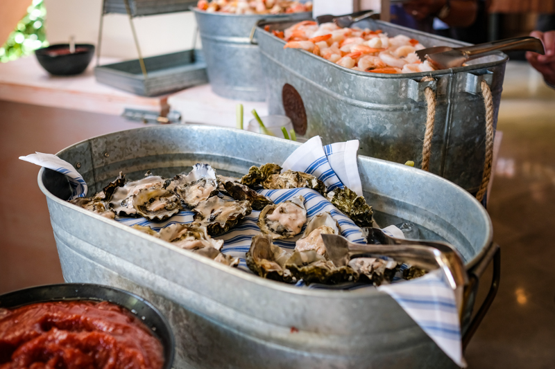Build your own seafood tower with fresh shucked oysters, crab knuckles, peeled shrimp and lobster parfait.