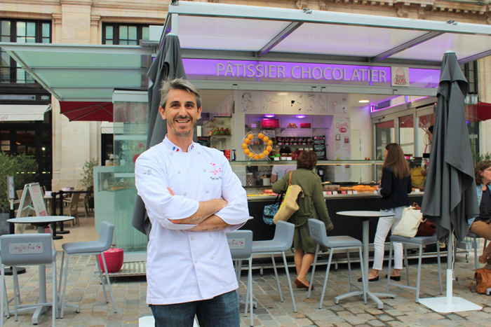 Cyril San Nicholas in front of one of his Corner San Nicholas shops in France.
