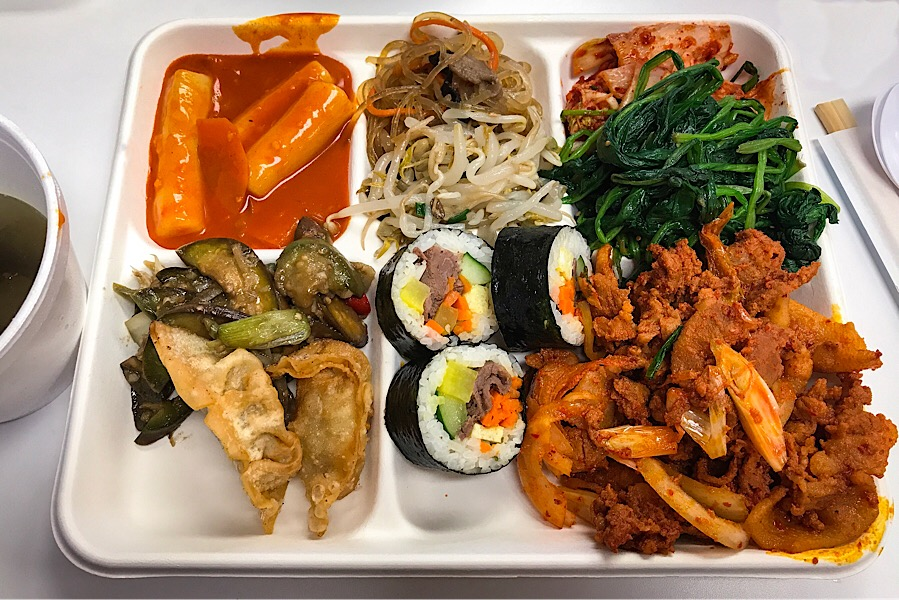 My plate with ddukbokki, japchae, namul, kimchi, spinach, eggplant, mandoo, kimbap and spicy pork bulgogi. I had some seaweed soup on the side.